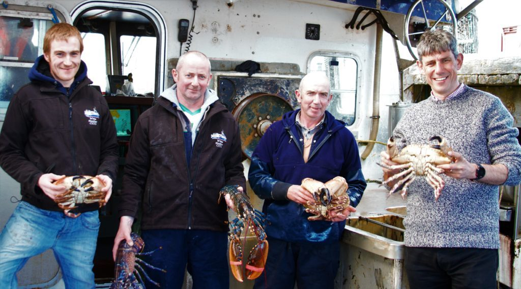 Alistair Dutton on board with the crew of the White Heather fishing boat.