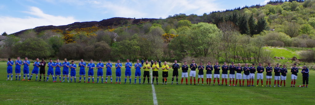 Scottish Amateur League president Matt Armstrong, right, leads both sets of players and match officials in a round of applause before Saturday's match for Duncan MacDougall and Przemek Krawczyk, victims of the Nancy Glen disaster. Duncan played in this fixture for the Argyll Select on a number of occasions.