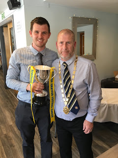 Argyll Select captain Fraser Talbot receives the Joe Paterson Memorial Trophy from Scottish Amateur Football League president Matt Armstrong.