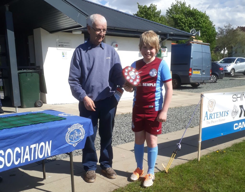 Kilmory's Harry Turner was presented with the Sheena Cameron Memorial Shield by Dougie Cameron.