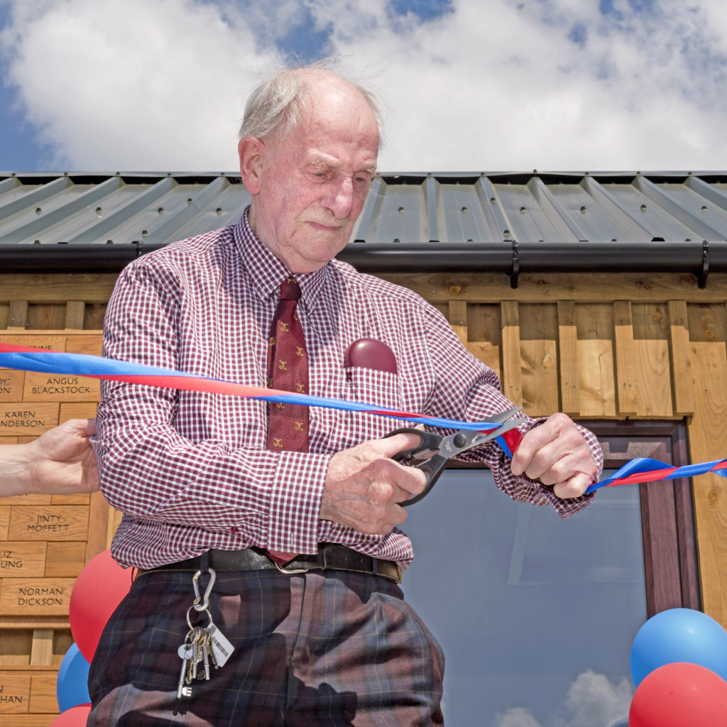 Ninety-five-year-old Tommy Wade officially opens the new facilities at The Dell before the Premiership game between Kingussie and Lochaber. Photo: Neil Pateson