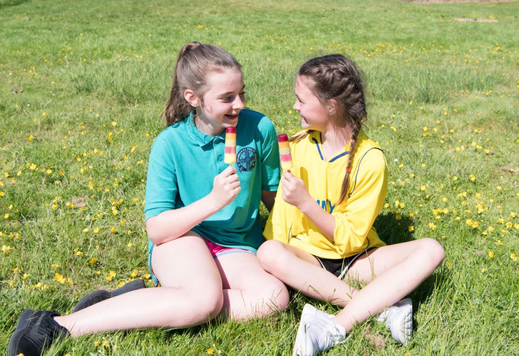 Friends Isla and Dana enjoying the glorious sunshine. JP F23 Inter Schools 05