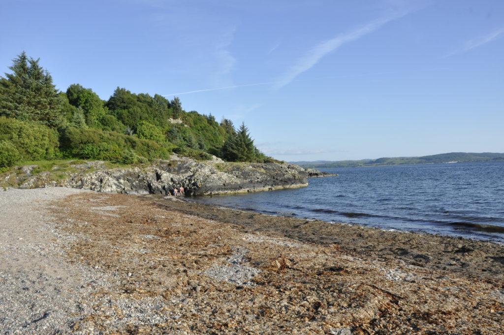 Rocky headland at Tralee Beach, a popular picnic spot