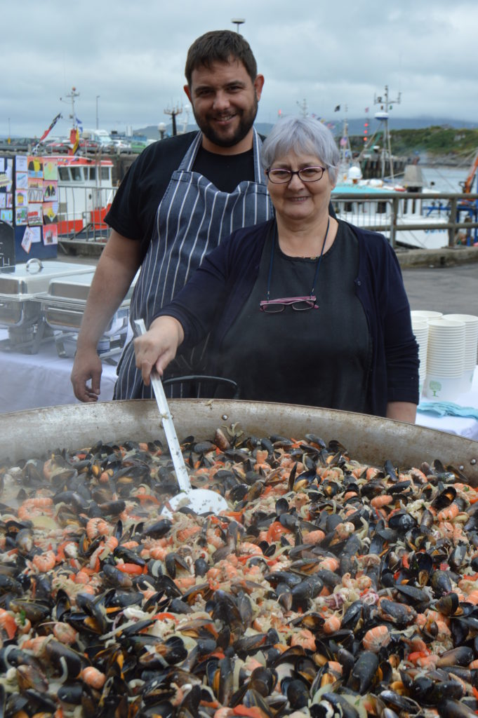 ​Harry Marshall and Jean MacNaughton of the West Highland Hotel once again cooked up and served two huge pans of seafood. Photograph: Joanne Simms