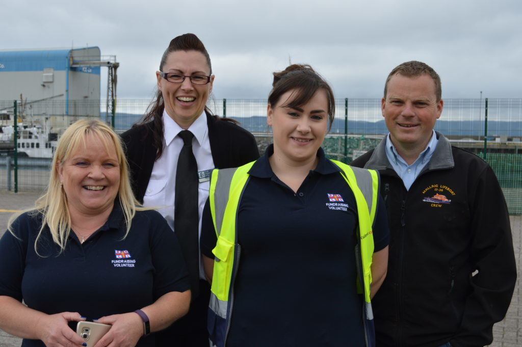 ​Audrey McKay, who chairs the RNI fundraising committee; Karen Calder of The Fishermen's Mission, Ellen McCaulay fund raising volunteer and Ross MacKay RNLI crew member. Photograph: Joanne Simms