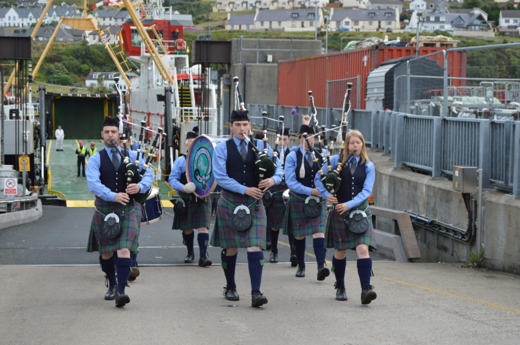 ​Isle of Skye Pipe Band marched off the ferry from Armadale and into Mallaig. Photograph: Joanne Simms