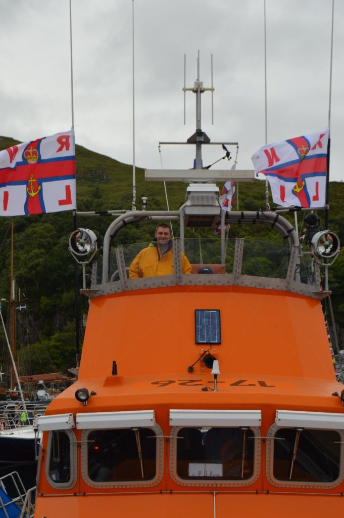 ​Crew member Hugo Martin on the flying bridge of the Severn class lifeboat at Mallaig.