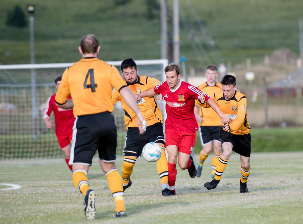 Martin Munro makes a bursting run through the Fort midfield. NO F30 Fort SLT 03