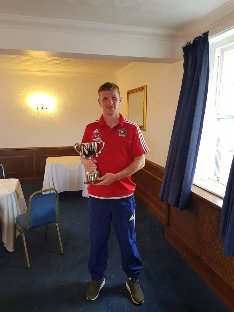 Oban Saints captain Dene Cassells with the Argyll and Bute Cup.