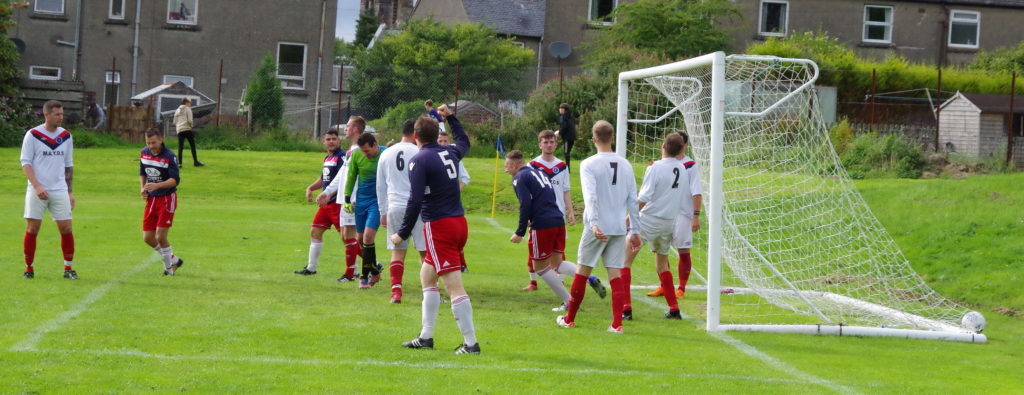 Shaun MacIver wheels away in celebration after heading the ball into the net to put Saints 2-0 in front in the final