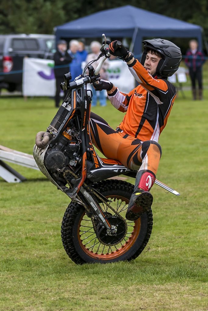 Andy Anderson performed stunts on his bike.