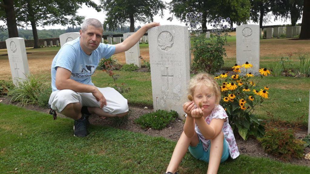 David Van Coolwijk with his daughter Lisa, six, at the aircrew graves.