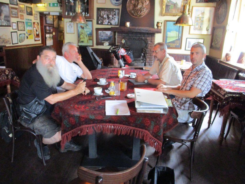 Volunteer group Willem Kroon, Frans-Jan ter Beek, Ger Boogsman and David Van Coolwijk at Café Ome Ko in Muiden.
