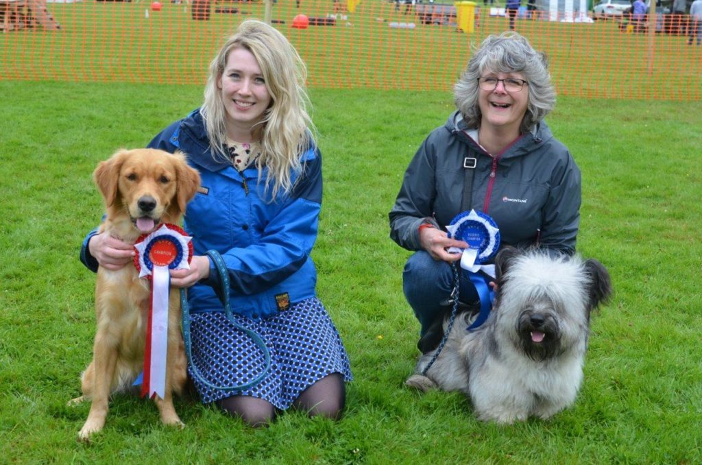 hristine Banks, left, and her best in show Golden Retriever Sally and runner-up Sarah Burd with her Skye Terrier Dougal