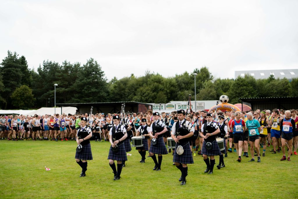 Lochaber Pipe Band lead the runners to the start line. NO F36 Ben Race 11