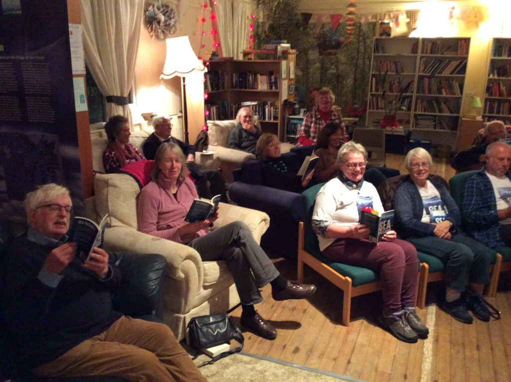 Festivalgoers enjoying the Reading Room at Benderloch's Victory Hall during Bookends.