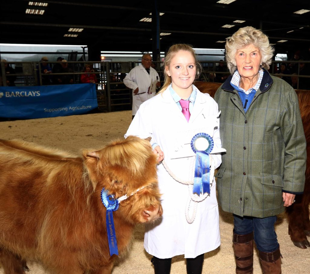 Iona Keyes from Kerrera was the runner up in the young handler senior section. She received her prize from Margaret Thomson of Woodneuk Fold. Picture by Kevin McGlynn.