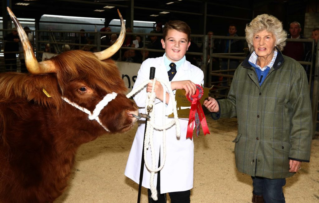 Young handler of the year Logan Ross receives his prize from Margaret Thomson from the Woodneuk Fold. Picture by Kevin McGlynn.
