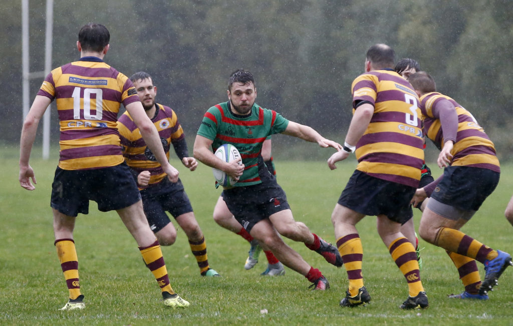 Oban Lorne captain Iwan Roberts weaves his way through the Loch Lomond defence.