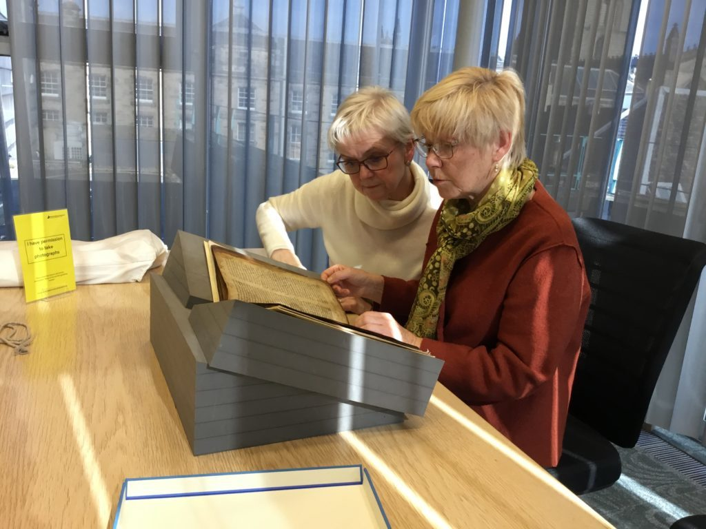 Breege Smyth and Marlyn Turbitt looking at the 12th-century Glenmasan manuscript in the National Library of Scotland in Edinburgh.