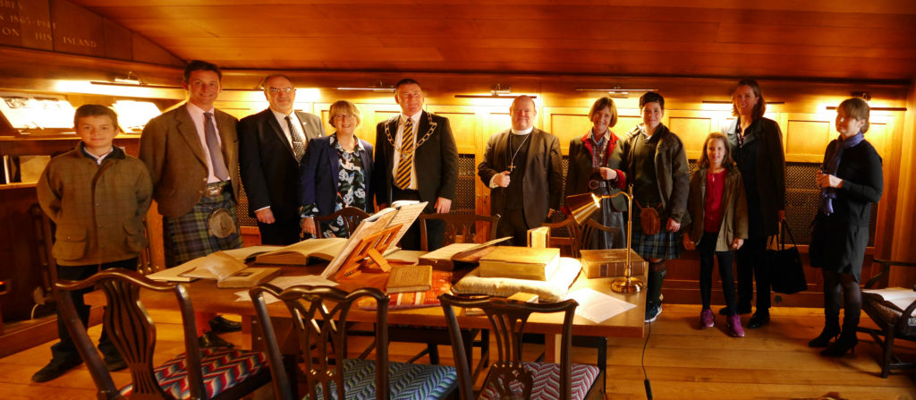 The Duke of Argyll and others celebrate the official opening of the new heritage collection at Iona Library. NO_T45_ionalibrary01