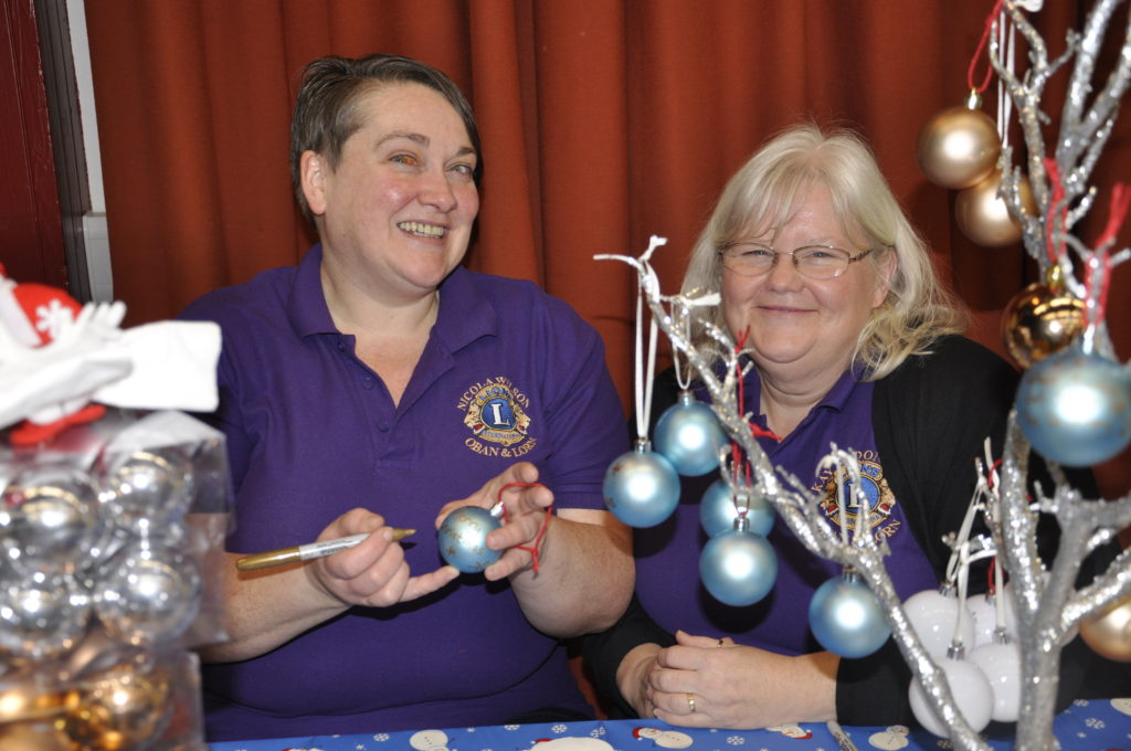 Nicola Wilson and Kay MacDonald from the Oban and Lorn Lions Club created and sold bespoke Christmas baubles. 17_T48_WinterFestivaSaturday02