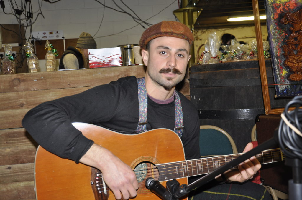 Italian guitarist Davide Guerra entertained people who attended the food and craft market. 17_T48_WinterFestivaSaturday06
