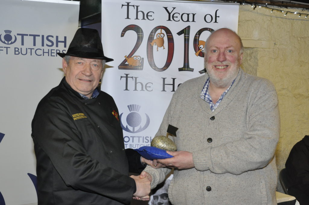 John Ackroyd picks up the Golden Haggis on behalf of McCaskie Butchers from Keith Fisher from the Institute of Meat. 17_T48_WinterFestivalSunday04