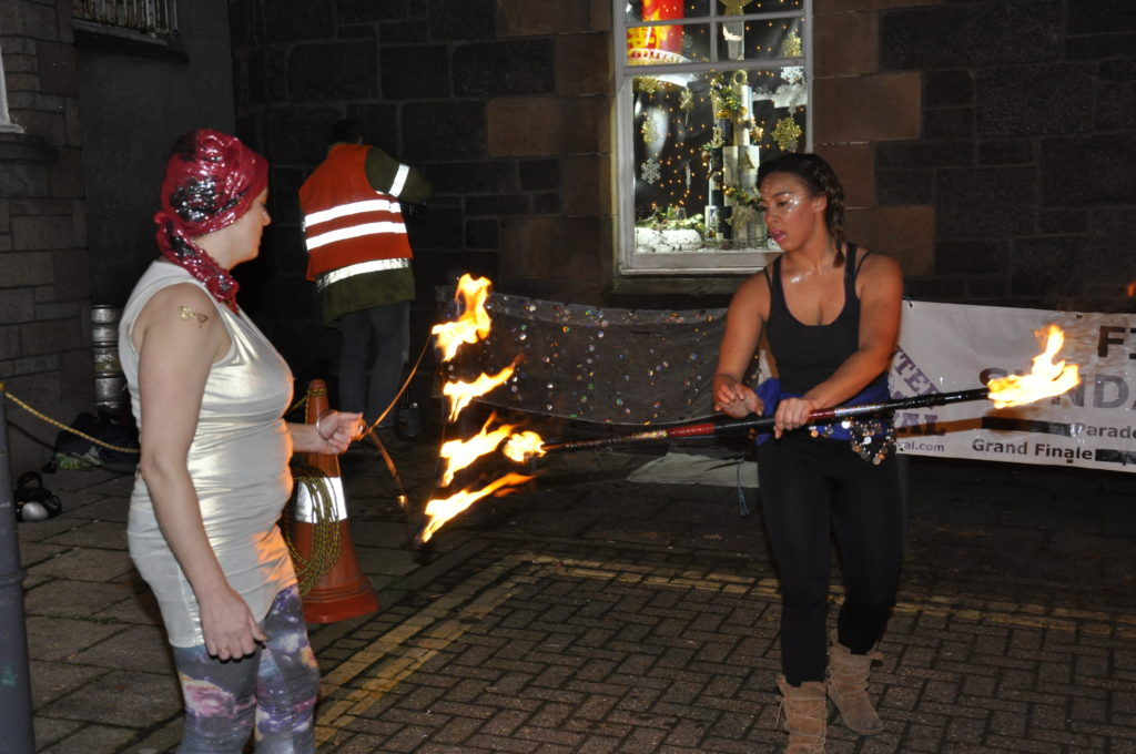 'Funky Chicken' entertainers perform with fire at Oban Distillery. 17_T48_WinterFestivalSunday09