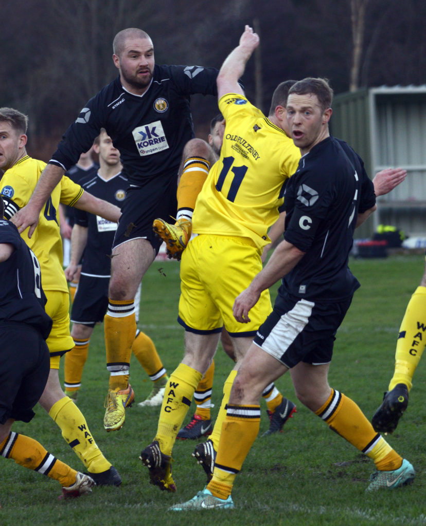 Fort William's Andy Martin and Darren Quigg see the ball out of play. NO F47 Fort Wick 01