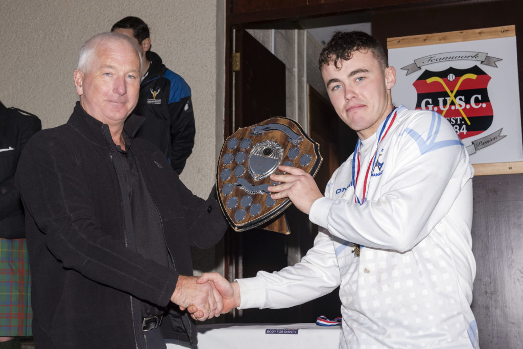 Skye captain Jamie Gillies received the London Shield from Willie Macdonald. Photos: Neil Paterson
