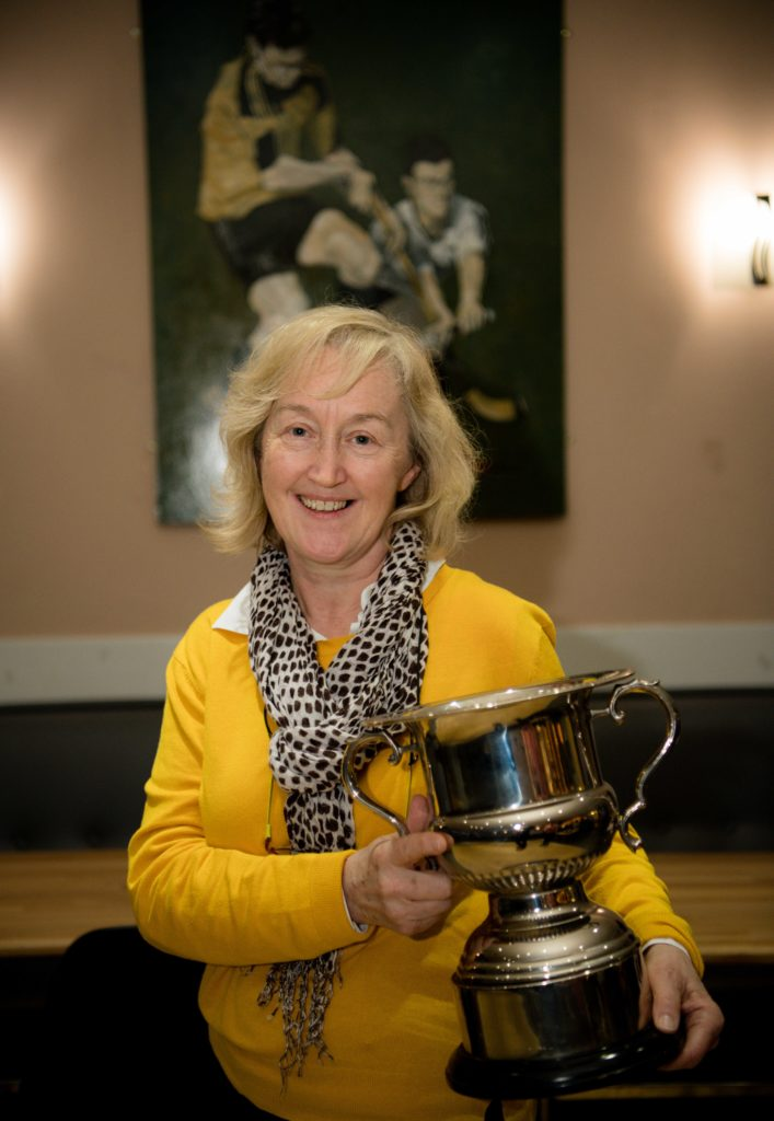 Liz Tangney accepted the player of the year trophy on behalf of her son James Tangney, who is out injured.