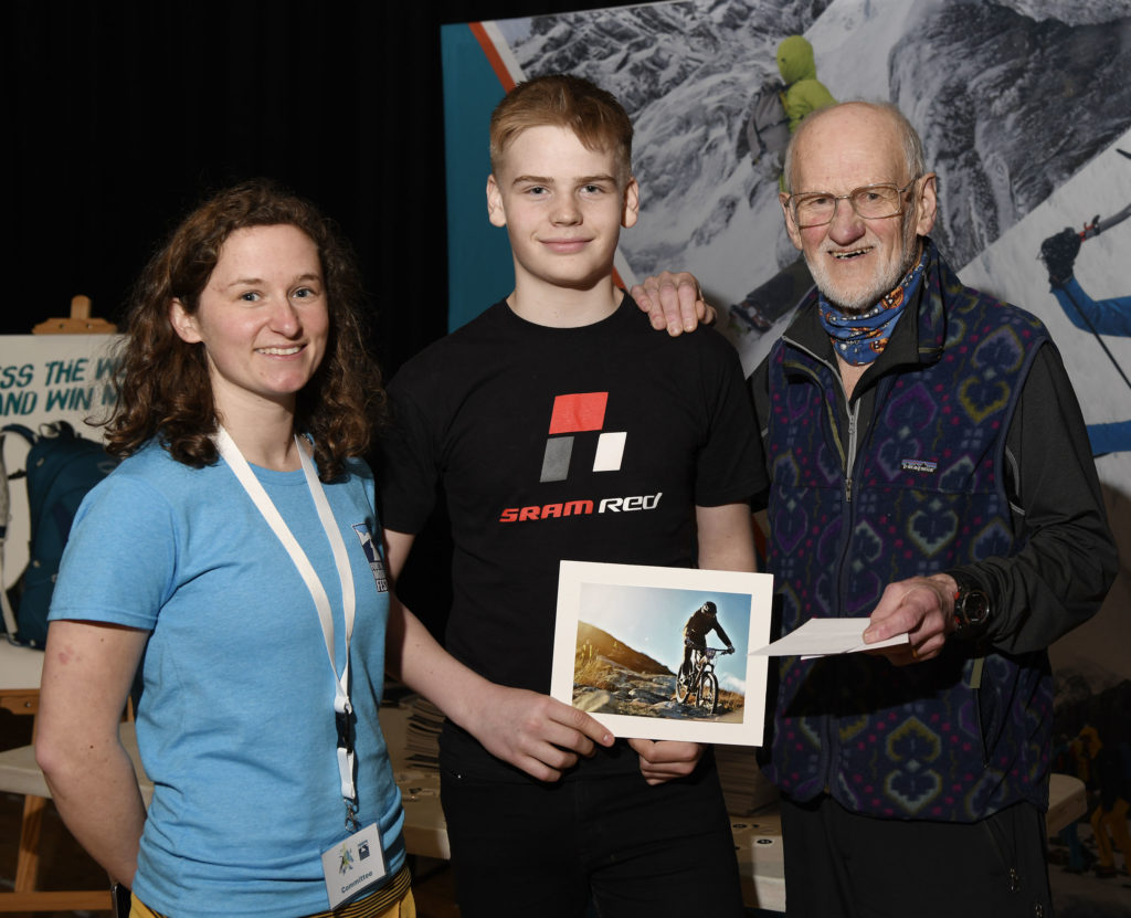 Winner of the Young Photographer of the Year competition, 14-year-old Ruaraidh Johnson, received his trophy from renowned local outdoor photographer Alex Gillespie, and competition organiser, Hannah Francis.
