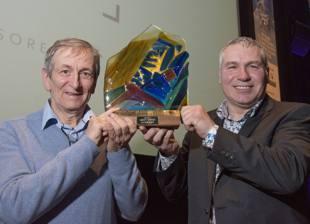 Former teacher Noel Williams was presented with the prestigious Scottish Award for Excellence in Mountain Culture by by Kerry MacDonald of sponsors, Liberty British Aluminium.