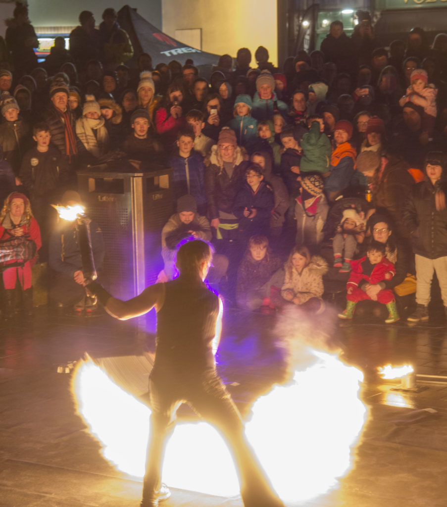 FlameOz's fiery performance at Cameron Square helped welcome home the runners who took part in the torch lit hillside procession to open this year's festival.