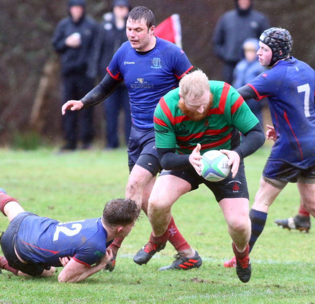 Oban Lorne's Calum MacLachlan goes over for a try in the match against Wigtonshire. Photograph: Kevin McGlynn.