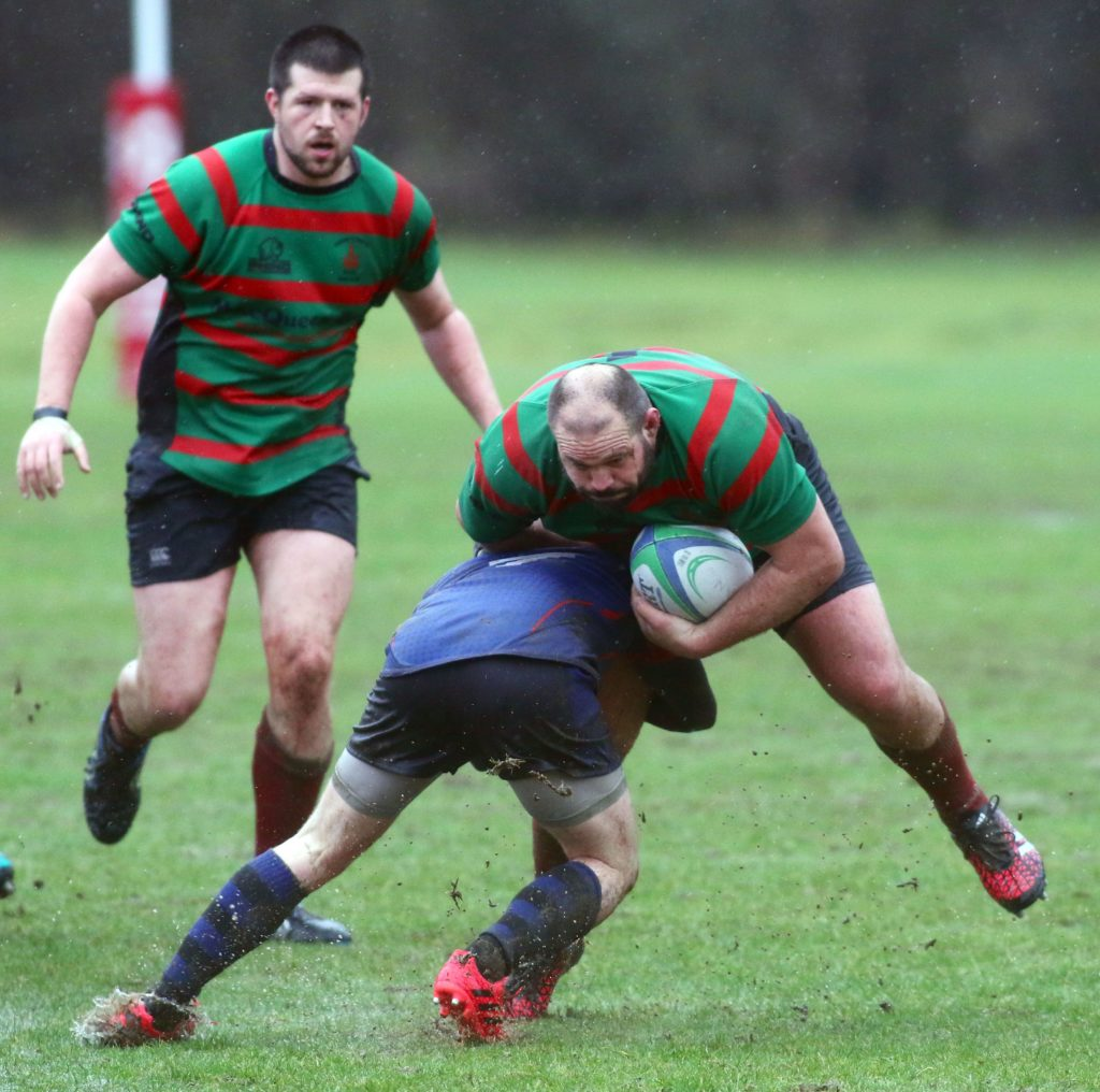 Corrie Louw, Oban Lorne, drives forward in the match with Wigtonshire. Photograph: Kevin McGlynn