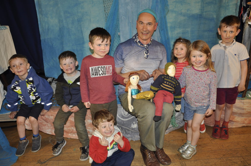 Youngsters getting hands-on with the puppets after watching The Lighthouse Keeper's tale