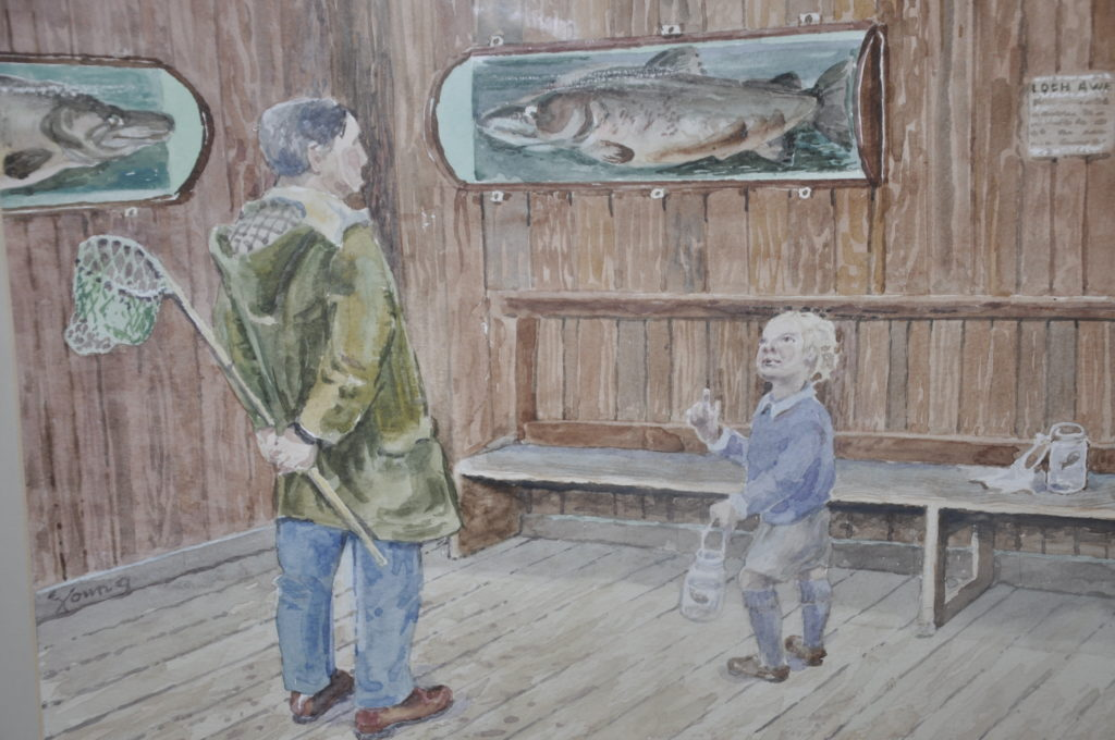 A charming scene of a dad and son gone 'fishing' admiring the salmon at Ardchattan Priory
