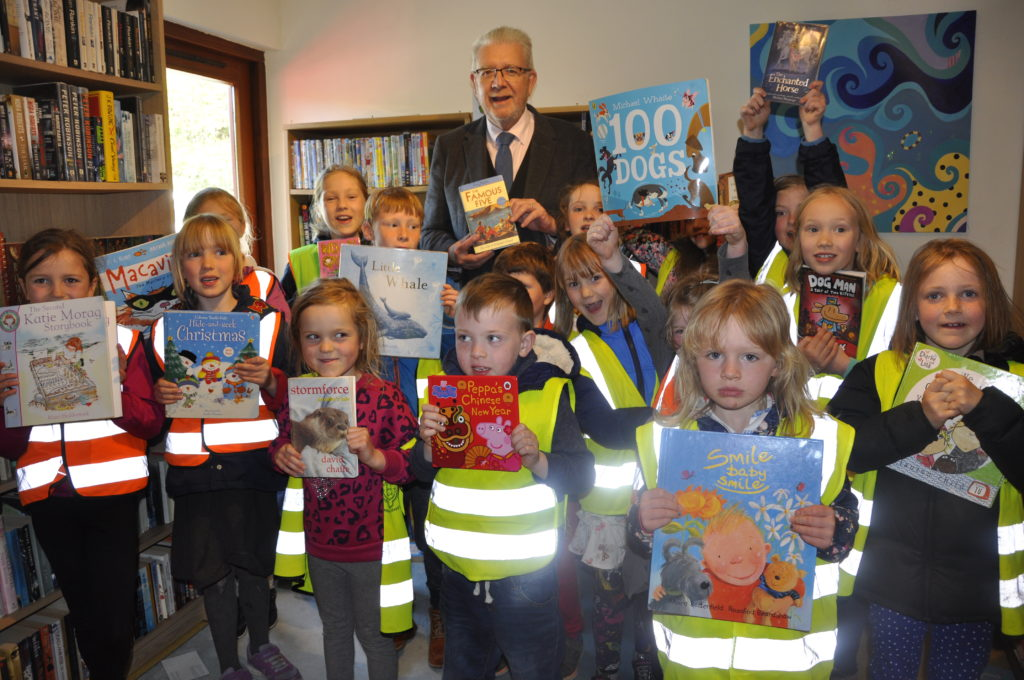 MSP Michael Russell with youngsters at Dervaig's new community library in the village hall.