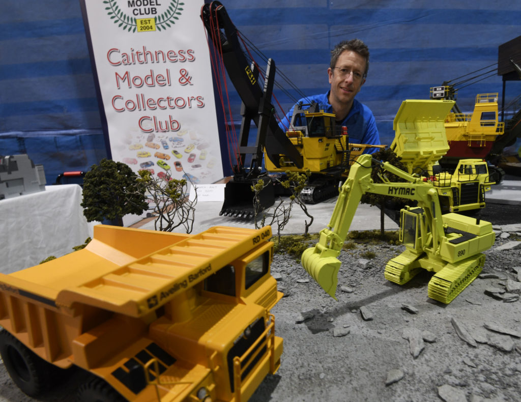 Local artist Jamie Hageman with his impressive collection of earth-moving equipment, much of it scratch built by himself. Picture Iain Ferguson, alba.photos  NO F19 Model show 05