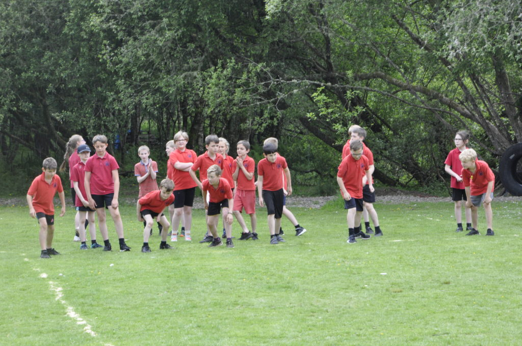 Primary 6/7 boys line up for the sprint.