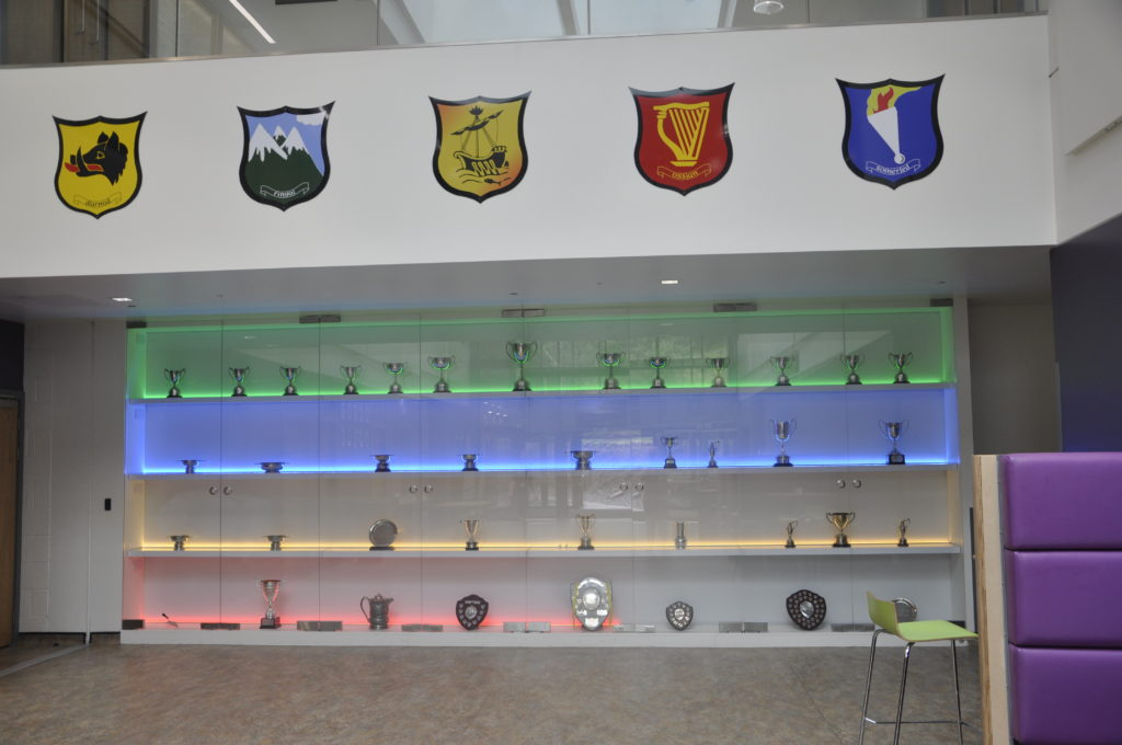 The stunning trophy cabinet is illuminated in clan colours.
