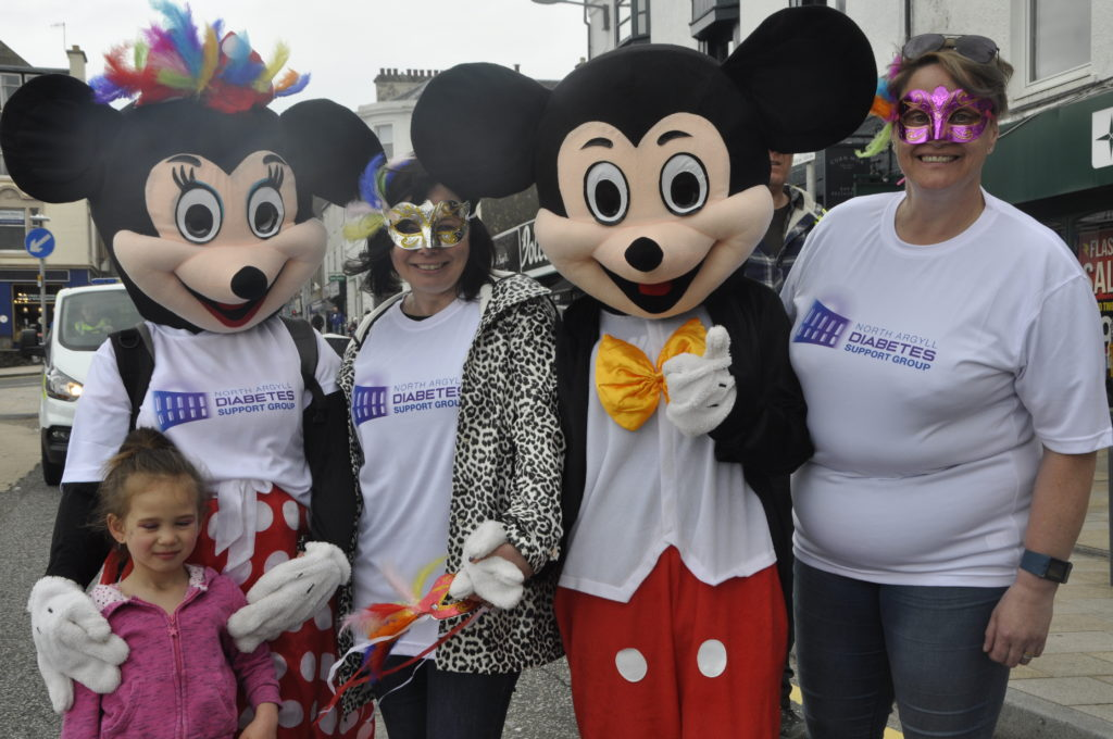 Mickey and Minnie Mouse put in a guest appearance as part of Oban Charities Day parade.