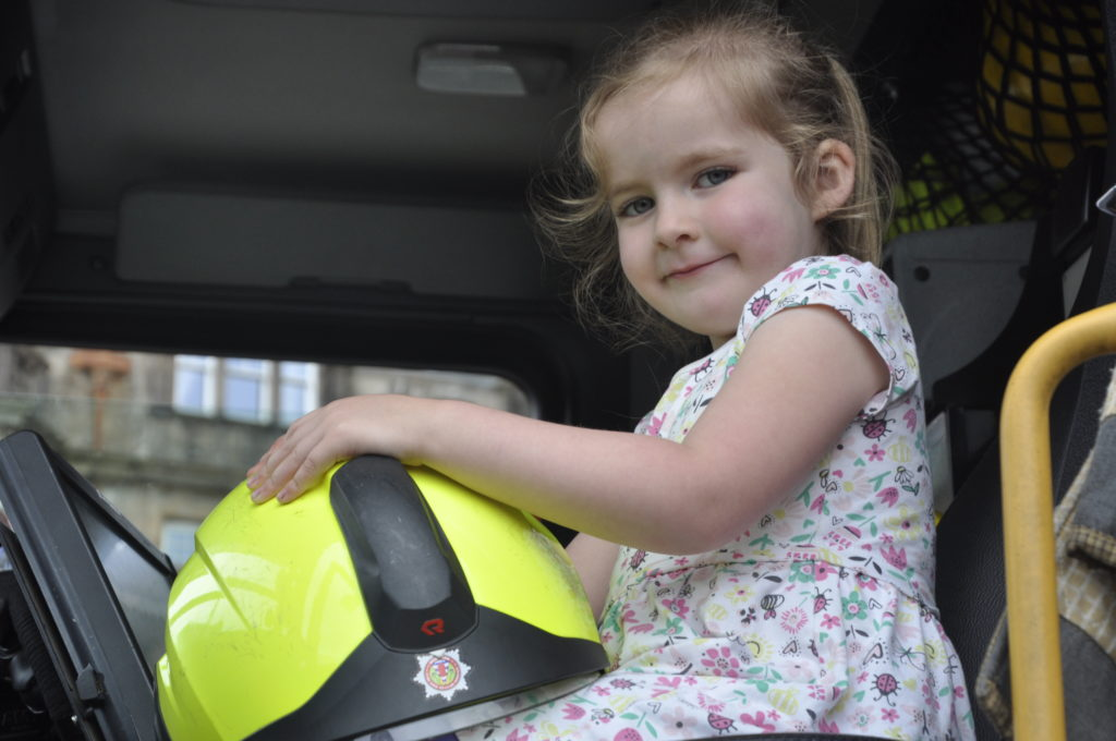 Cece MacDougal, 4, gets to sit in a fire engine at Oban Charities Day.
