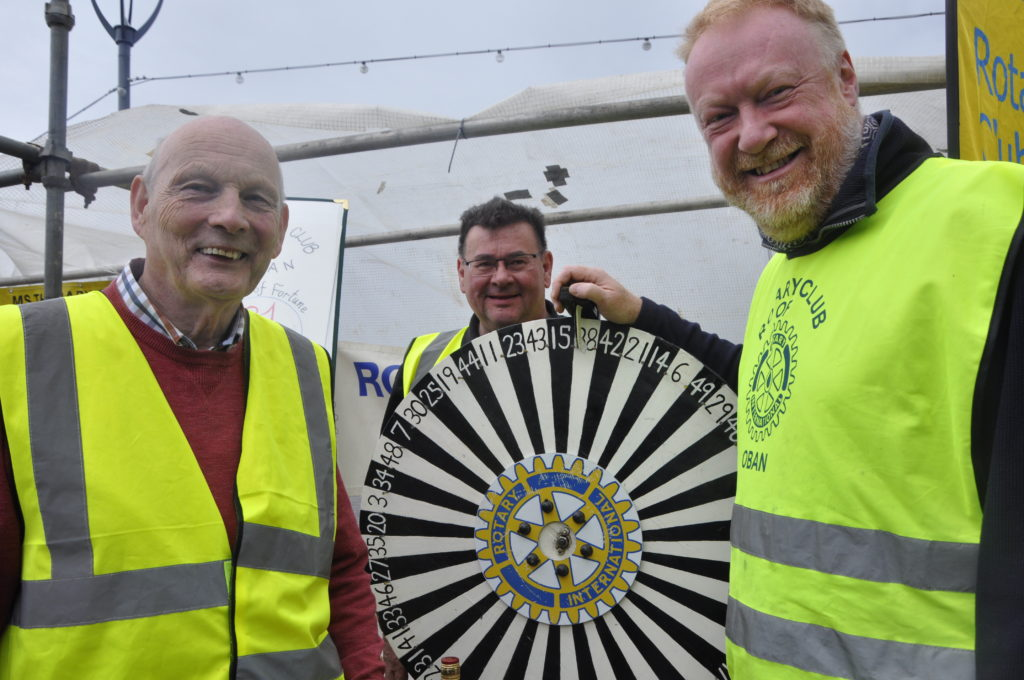 Rotarians spin the wheel for good causes.