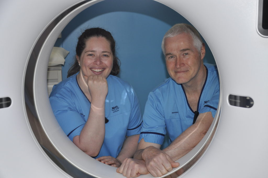 Luanna Lamers and Mark Nichols with the new CT scanner at Oban Lorn and the Isles Hospital