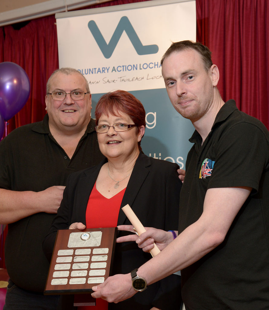 Best Volunteer Supporting Organisation went to Nevis Radio, with the award presented to John Weller, left, and Simon Abberley by VAL Manager Flora McKee.  NO-F24-VOSCAR-06.jpg