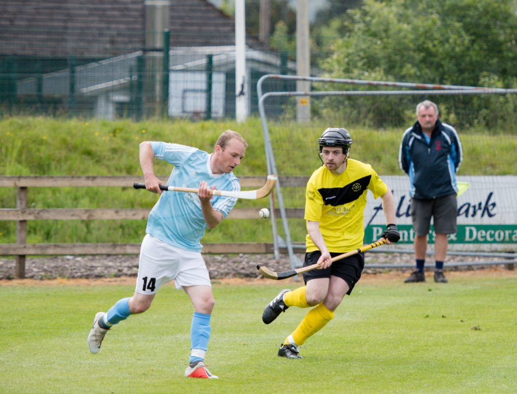 Fort William's Sean Cameron keeps a close eye on the ball in the Tulloch Homes Camanachd Cup second round match against  Caberfeidh on Saturday. Photograph: Abrightside Photography.