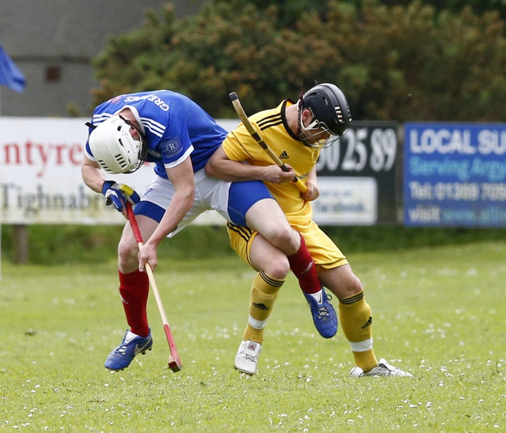 Scott MacDonald, Kyles Athletic, and Connor Howe of Inveraray tussle for the ball at Tighnabruaich. Photograph: Stephen Lawson.